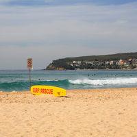 Yellow life saving board, Manly beach. Australia.