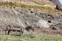 RIPPONVALE, CENTRAL OTAGO, NEW ZEALAND - FEBRUARY 17 : Old wooden cannon carriage in the gold mining area of Ripponvale in New Zealand on February 17, 2012. Two unidentified people