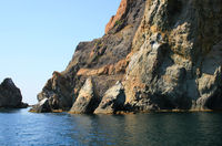 Mountain on a rocky coastline.View from sea.