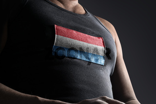 The national flag of Luxembourg on the athlete's chest