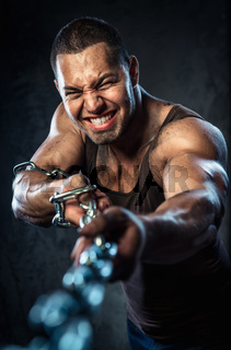 Muscular man pulling the chain