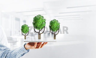 Eco green environment concept presented by tree as working mechanism or engine