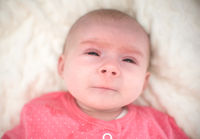 Newborn with very sad face start to cry