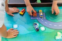 Children playing with cars and boats
