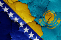flags of Bosnia and Herzegovina and Kazakhstan painted on cracked wall