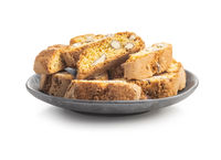 Italian cantuccini cookies on plate. Sweet dried biscuits with almonds.