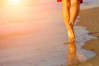 Running legs of runner on beach
