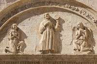 Assisi village in Umbria region, Italy. Detail of the most important Italian Basilica dedicated to St. Francis - San Francesco.