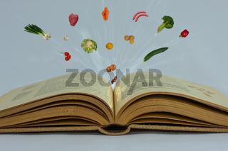 Geöffnetes Kochbuch mit Rezepten frisches Gemüse