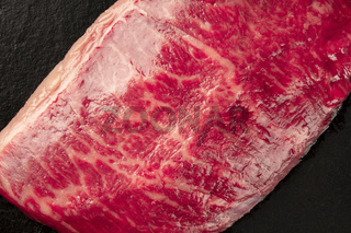 Kobe meat, wagyu beef steak, close-up on black