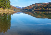 Vilshany water reservoir on the Tereblya river, Transcarpathia, Ukraine. Picturesque lake with clouds reflection. Beautiful autumn day in Carpathian Mountains.