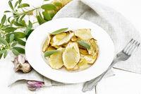 Parsnips baked in plate on light board