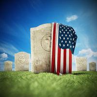 American flag on gravestone in veterans cemetery. 3D illustration