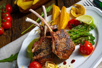 Lamb chops marinated in herbs with green asparagus and lime