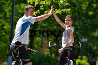Happy couple ridine bicycle outdoors