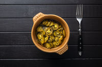 Pickled sliced jalapeno. Green jalapeno peppers in bowl.