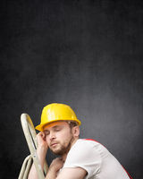 Portrait of a lazy worker with ladder