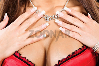 woman's breasts and neck with a necklace