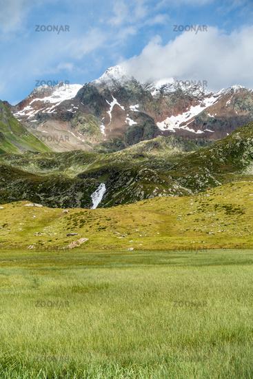 Beautiful view over a wetland towards the Botzer mountain peak, Timmelsjoch, Tirol, Italy