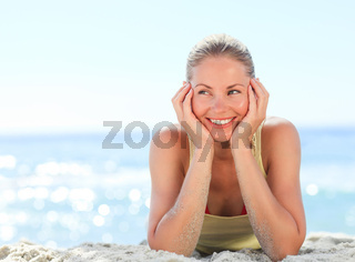 Lovely woman sunbathing at the beach