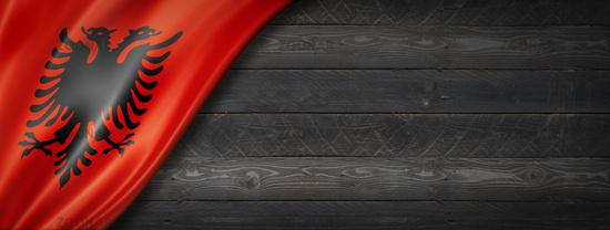 Albanian flag on black wood wall banner