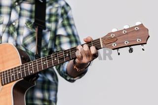 Human hand holding guitar music instrument