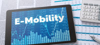 A tablet with financial documents - E-Mobility