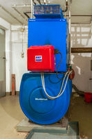 Old blue Buderus G 105 heating boiler with red Ray oil burner