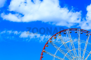 People ride a ferris wheel in the city park