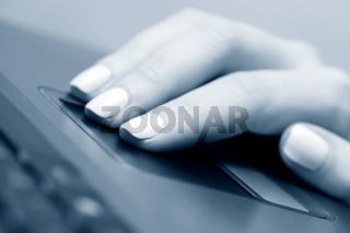 Female hand using touchpad