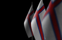 Small national flags of the Faroe Islands on a black background