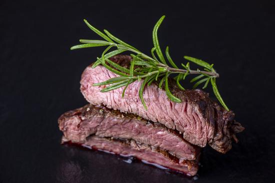 grilled steak on black slate