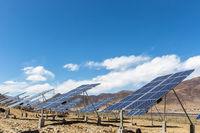 solar power plant on plateau against a blue sky