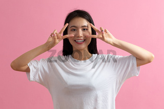Portrait of asian woman on pink background