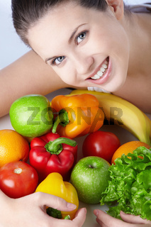 Attractive young girl with fruits and vegetables