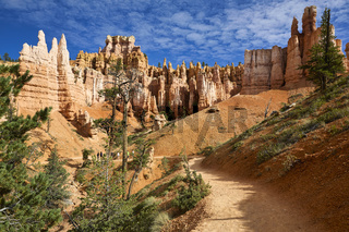 Tourists hiking among the hoodoohs in the Queens Garden Trail. Bryce Canyon National Park. Utah USA