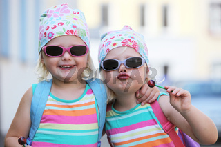 Two little identical twins in sunglasses