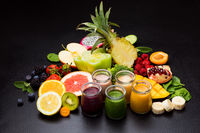 Group of different fruit smoothies in glasses various vegetables and fruits