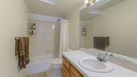 Pano Interior of a bathroom with wall lightning, vanity sink and bathtub