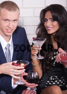 Couple on date in bar or night club enjoying wine