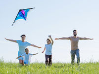 Family running with outstretched arms
