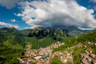Seriana valley and Orobie Alps with big cloud and blue sky