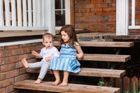 Content siblings on wooden stairs