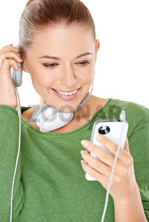 Woman listening to a new music download