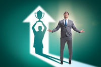 Businessman dreaming of top prize in business concept