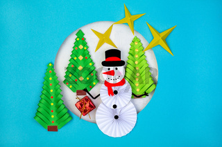 Craft Christmas card cut out of paper.