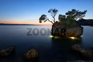 Sunset at beach with Kamen Brela (Brela Stone), Brela, Adriatic Sea, Croatia