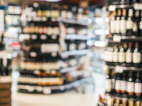 Abstract blurred supermarket shelves with alcohol, wine bottles