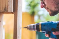 Do it yourself: Home Handyman is using a cordless screwdriver for screwing
