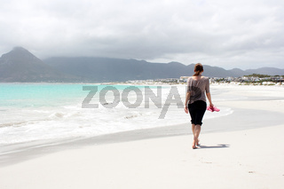 Beach of Kommetjie with an upcoming storm in the background